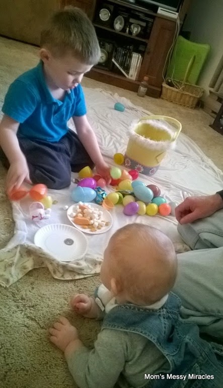 Owen and Charlie opening Easter eggs