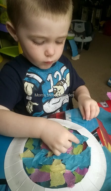 Charlie making paper plate sun catcher
