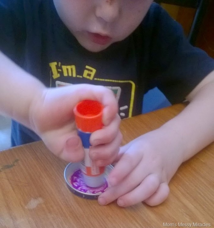 putting glue inside the baby food lids