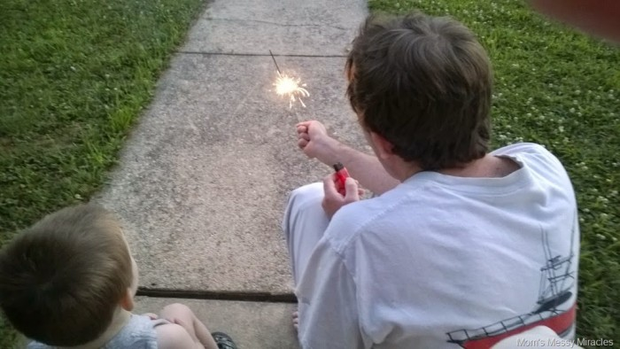 watching daddy play with sparkler