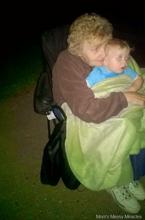 Owen watching fireworks with mommom