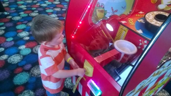 catching popcorn game at Fun Warehouse