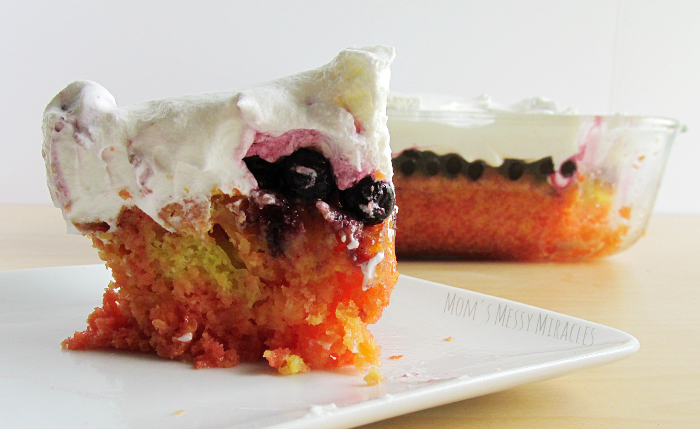 Triple Berry Lemonade Poke Cake sliced