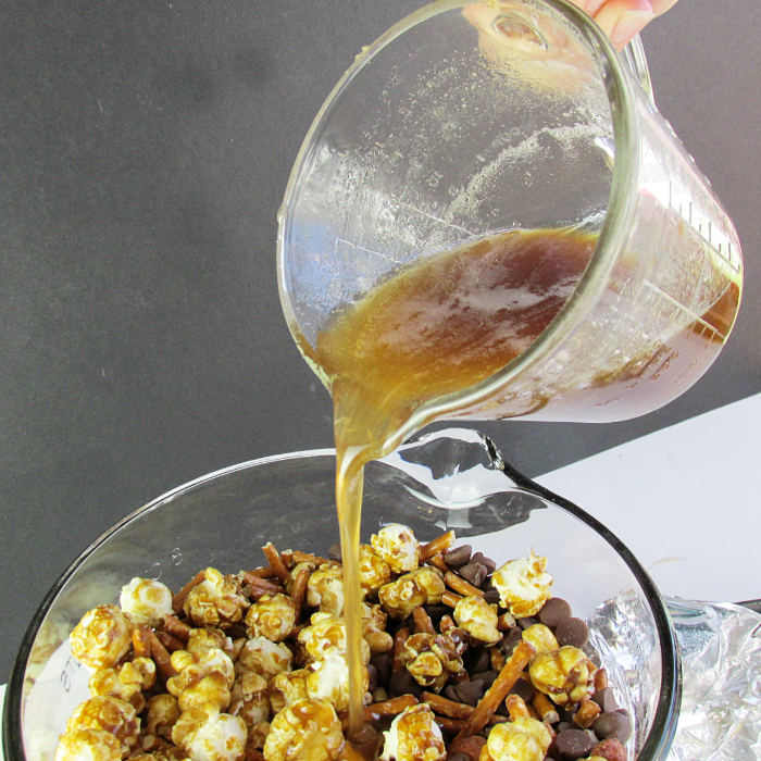 Pouring Syrup into cereal mix