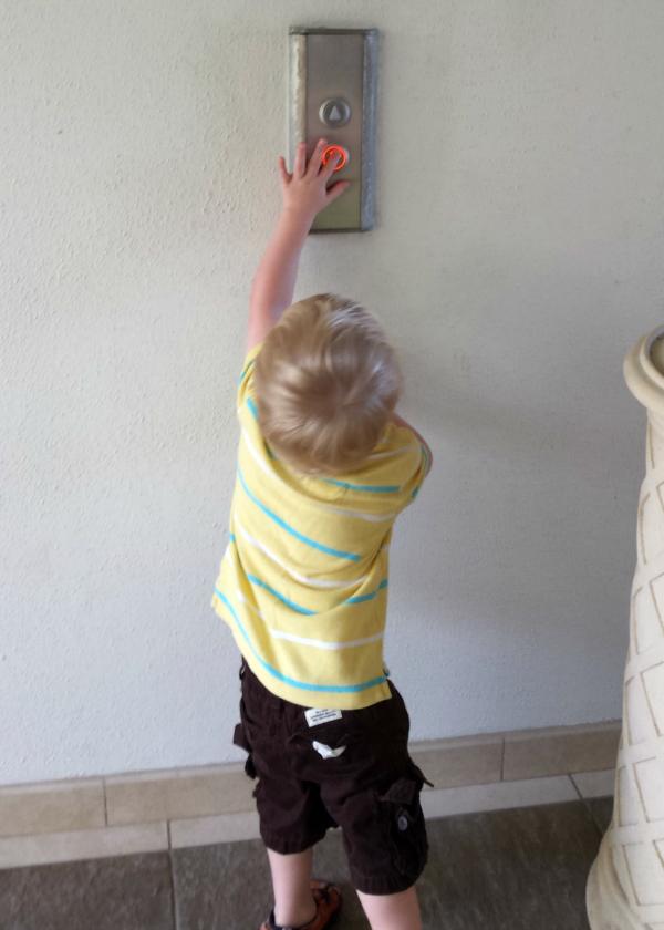 Owen pushing elevator button