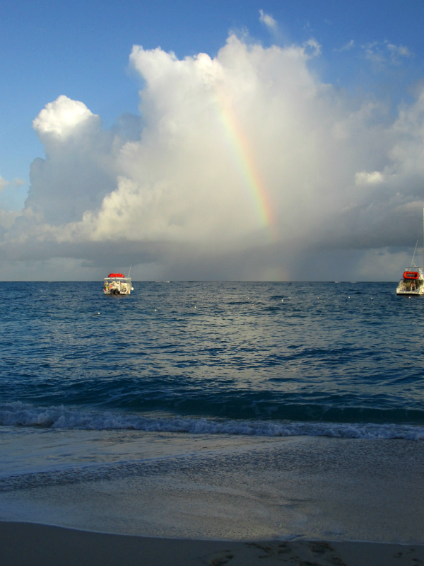 Rainbow between boats at Beaches