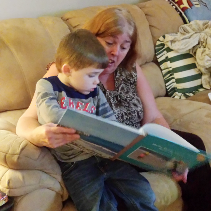 Sharing Family Photo Book with Nanny