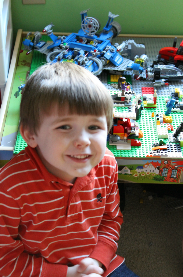 Charlie with his LEGO world