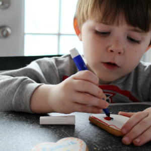 Coloring on heart cookies