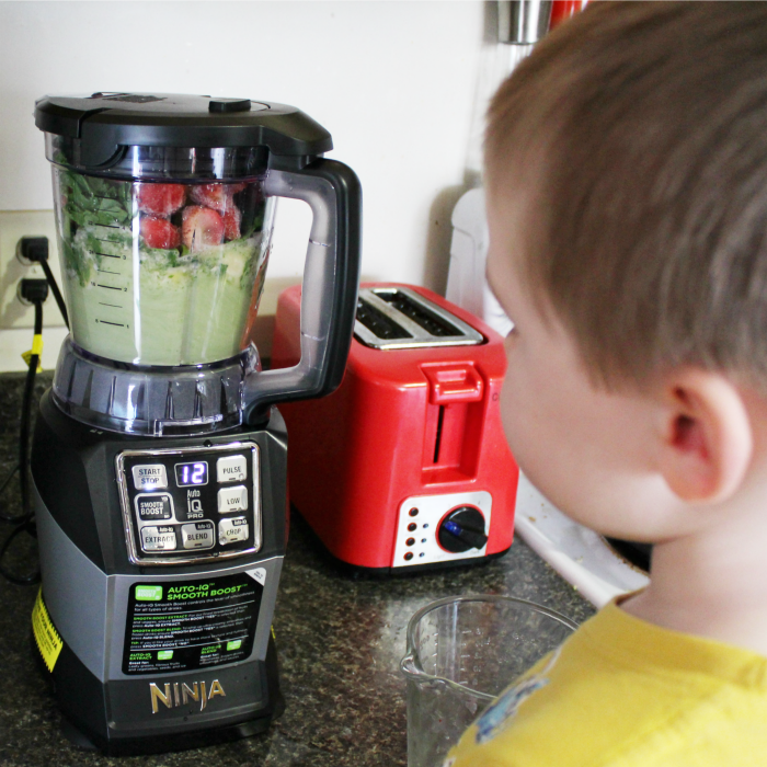 Blending our Strawberry-Pineapple Kale Smoothie