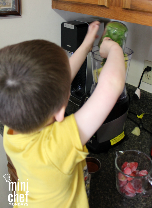 Mini Chef adding Kale to Nutri Ninja