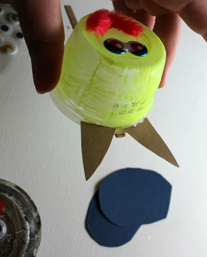 glue cat ears on applesauce cup puppet