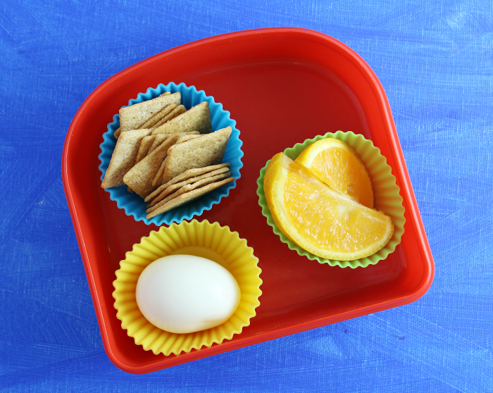 Hard-boiled egg crackers oranges lunch