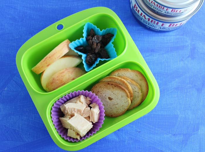 Tuna bagel chips raisins apples lunch