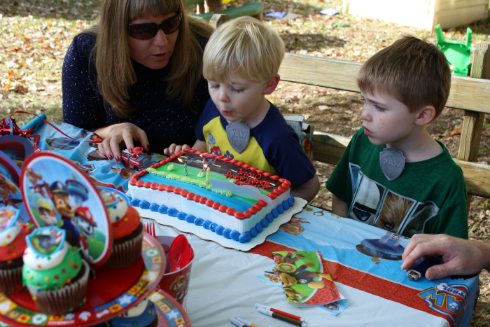 owen-blowing-out-3rd-birthday-candles